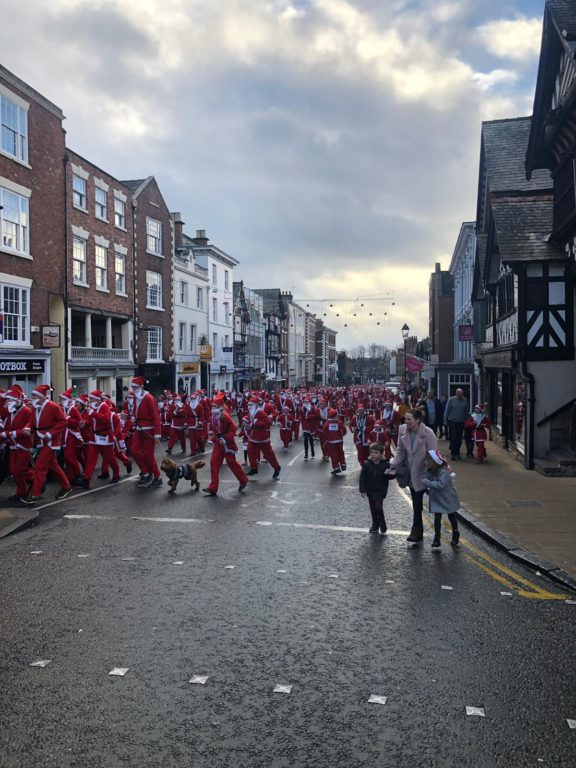 A sea of Santas dashing up Lowe Bridge Street, Chester